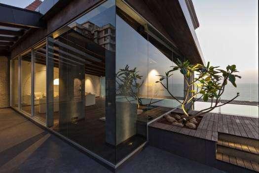 Look at the Luxurious Sea-Facing Duplex Apartment of John